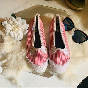 Red and white striped Keds